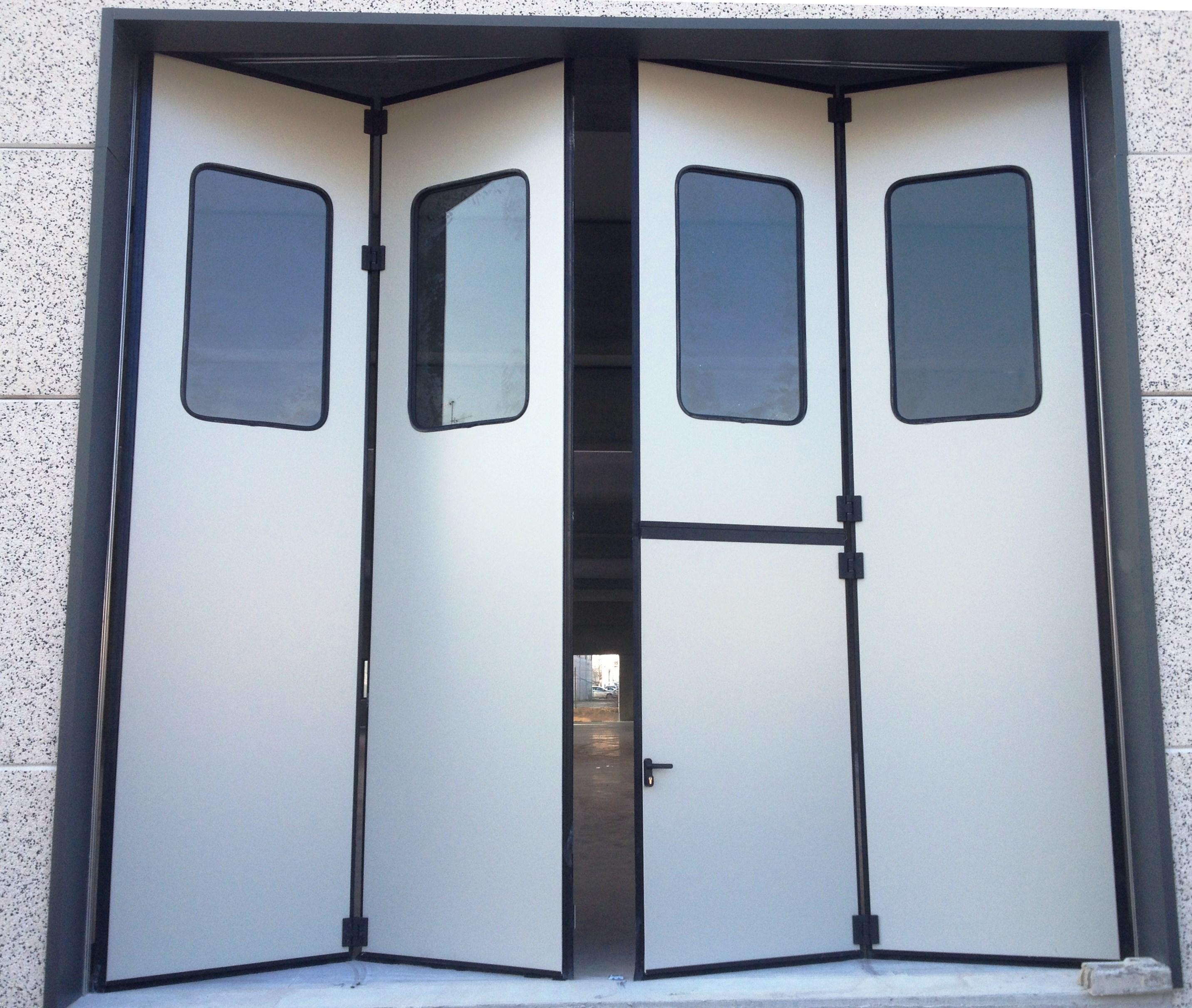 Portoni a libro per capannoni terminali antivento per for Coil porte rapide
