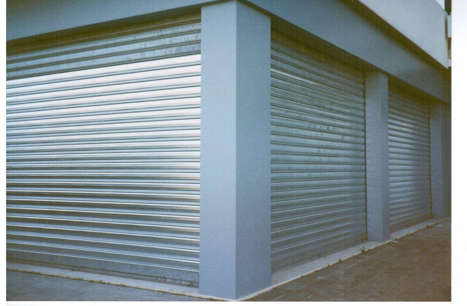 Serrande avvolgibili per garage firenze asc automazioni for Costo per aggiungere spazio sul garage